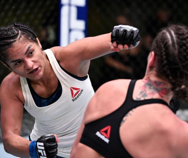 LAS VEGAS, NEVADA - JUNE 13: (L-R) Cynthia Calvillo punches Jessica Eye in their flyweight fight during the UFC Fight Night e