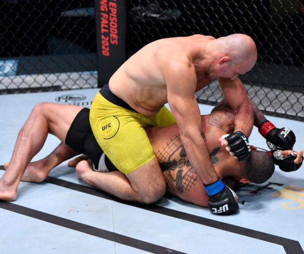 LAS VEGAS, NEVADA - NOVEMBER 07: (L-R) Glover Teixeira of Brazil punches Thiago Santos of Brazil in a light heavyweight fight