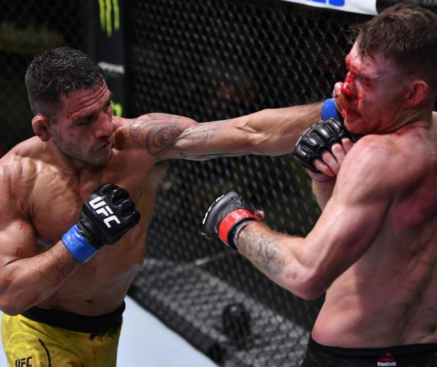 LAS VEGAS, NEVADA - NOVEMBER 14: (L-R) Rafael Dos Anjos of Brazil punches Paul Felder in a lightweight fight during the UFC Fight Night