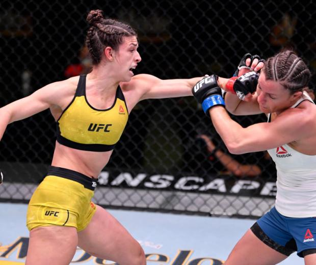 LAS VEGAS, NEVADA - MAY 30: (L-R) Mackenzie Dern punches Hannah Cifers in their strawweight fight during the UFC Fight Night