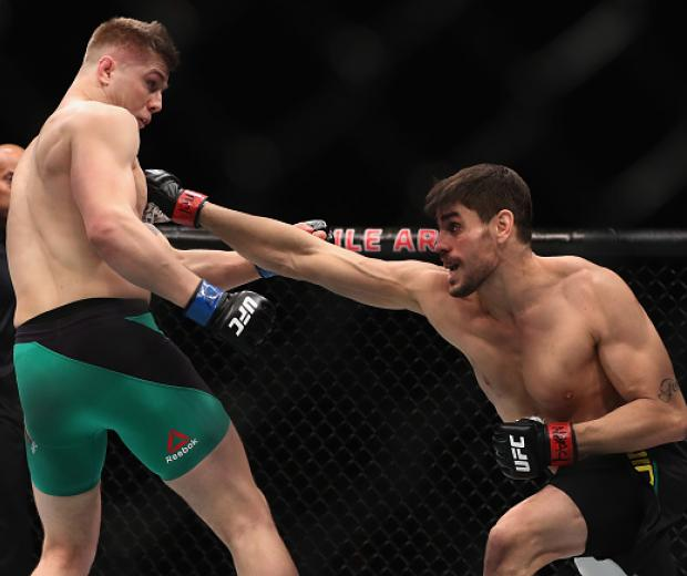 LAS VEGAS, NV - DECEMBER 30: (R-L) Antonio Carlos Junior of Brazil punches Marvin Vettori of Italy in their middleweight bout during the UFC 207 event on December 30, 2016 in Las Vegas, Nevada.  (Photo by Christian Petersen/Getty Images)
