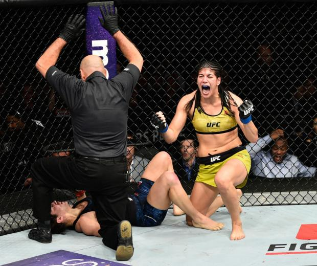 EDMONTON, AB - SEPTEMBER 09:  (R-L) Ketlen Vieira of Brazil celebrates her submission victory over Sara McMann in their women's bantamweight bout during the UFC 215 event inside the Rogers Place on September 9, 2017 in Edmonton, Alberta, Canada. (Photo by