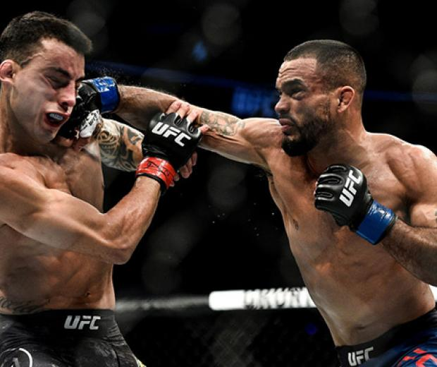 BOSTON, MA - JANUARY 20:  (R-L) Rob Font punches Thomas Almeida of Brazil in their bantamweight bout during the UFC 220 event at TD Garden on January 20, 2018 in Boston, Massachusetts. (Photo by Brandon Magnus/Zuffa LLC/Zuffa LLC via Getty Images)