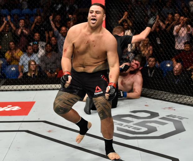PERTH, AUSTRALIA - FEBRUARY 11:  (L-R) Tai Tuivasa of Australia celebrates his victory over Cyril Asker of France in their heavyweight bout during the UFC 221 event at Perth Arena on February 11, 2018 in Perth, Australia. (Photo by Jeff Bottari/Zuffa LLC/