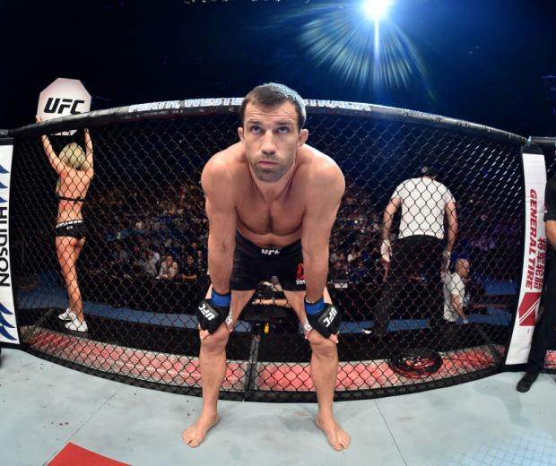 PERTH, AUSTRALIA - FEBRUARY 11:  Luke Rockhold enters the Octagon before facing Yoel Romero of Cuba in their interim middleweight title bout during the UFC 221 event at Perth Arena on February 11, 2018 in Perth, Australia. (Photo by Jeff Bottari/Zuffa LLC