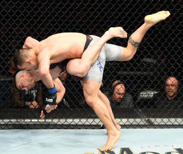 CHICAGO, ILLINOIS - JUNE 09:  (L-R) Ricardo Lamas takes down Mirsad Bektic of Bosnia in their featherweight fight during the UFC 225 event at the United Center on June 9, 2018 in Chicago, Illinois. (Photo by Josh Hedges/Zuffa LLC/Zuffa LLC via Getty Image