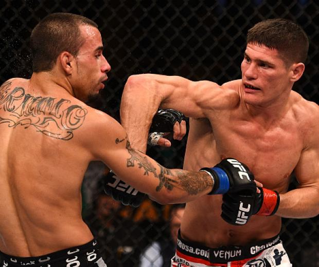 (R-L) Charles Rosa punches Sean Soriano in their featherweight fight during the UFC Fight Night event at the TD Garden on January 18, 2015 in Boston, MA. (Photo by Jeff Bottari/Zuffa LLC)