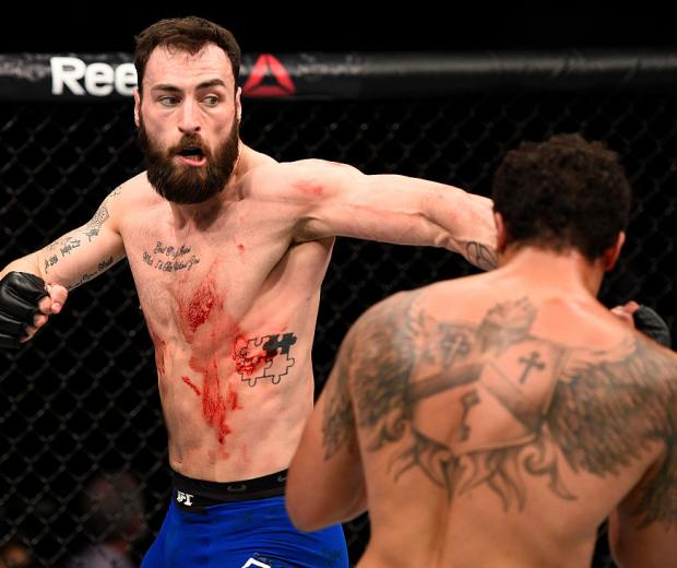 SACRAMENTO, CA - DECEMBER 17:  (L-R) Paul Craig of Scotland punches Henrique da Silva of Brazil in their light heavyweight bout during the UFC Fight Night event inside the Golden 1 Center Arena on December 17, 2016 in Sacramento, California. (Photo by Jef