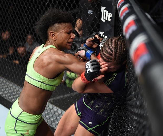 LAS VEGAS, NEVADA - DECEMBER 12: (L-R) Angela Hill elbows Emily Kagan in their strawweight fight during The Ultimate Fighter Finale event inside the Pearl concert theater at the Palms Casino Resort on December 12, 2014 in Las Vegas, Nevada. (Photo by Jeff