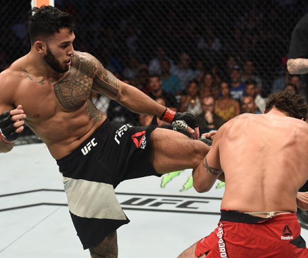 LAS VEGAS, NV - JULY 07:  (L-R) Brad Tavares kicks Elias Theodorou of Canada in their middleweight bout during The Ultimate Fighter Finale at T-Mobile Arena on July 7, 2017 in Las Vegas, Nevada.  (Photo by Brandon Magnus/Zuffa LLC/Zuffa LLC via Getty Imag