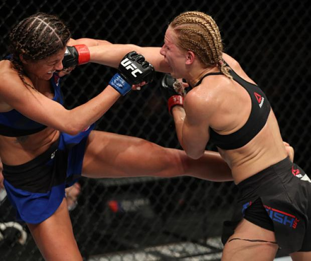 ALBANY, NY - DECEMBER 09:  (R-L) Justine Kish of Russia punches Ashley Yoder in their womens strawweight bout during the UFC Fight Night event at the Times Union Center on December 9, 2016 in Albany, New York. (Photo by Patrick Smith/Zuffa LLC/Zuffa LLC v
