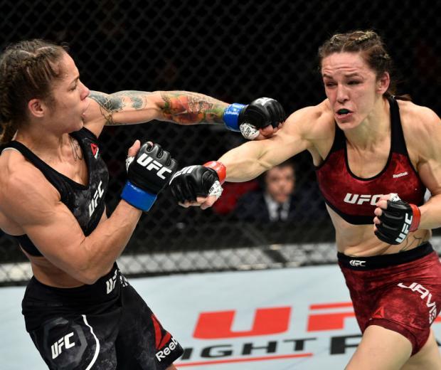 FRESNO, CA - DECEMBER 09:  (R-L) Alexis Davis of Canada punches Liz Carmouche in their women's flyweight bout during the UFC Fight Night event inside Save Mart Center on December 9, 2017 in Fresno, California. (Photo by Jeff Bottari/Zuffa LLC/Zuffa LLC vi