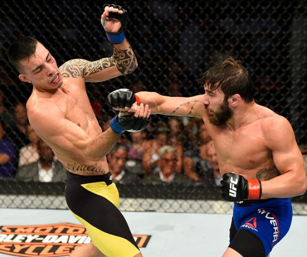 UNIONDALE, NY - JULY 22:  (R-L) Jimmie Rivera punches Thomas Almeida of Brazil in their bantamweight bout during the UFC Fight Night event inside the Nassau Veterans Memorial Coliseum on July 22, 2017 in Uniondale, New York. (Photo by Josh Hedges/Zuffa LL