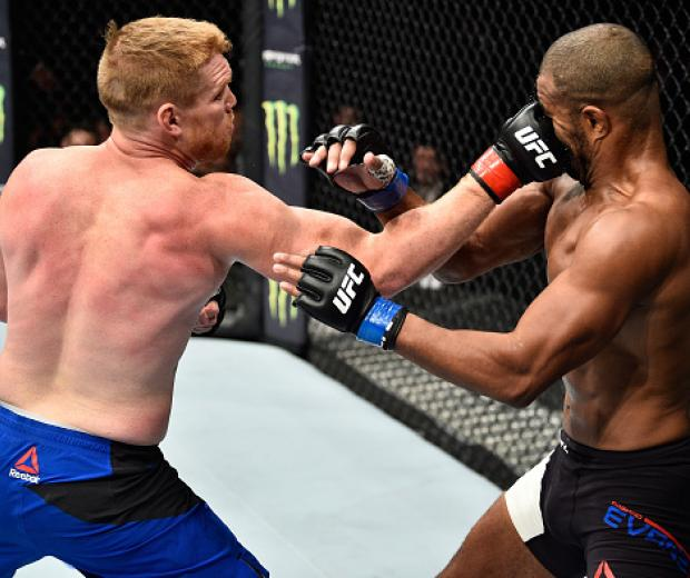 MEXICO CITY, MEXICO - AUGUST 05:  (L-R) Sam Alvey punches Rashad Evans in their middleweight bout during the UFC Fight Night event at Arena Ciudad de Mexico on August 5, 2017 in Mexico City, Mexico. (Photo by Jeff Bottari/Zuffa LLC/Zuffa LLC via Getty Ima