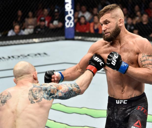 ORLANDO, FL - FEBRUARY 24:  (R-L) Jeremy Stephens punches Josh Emmett in their featherweight bout during the UFC Fight Night event at Amway Center on February 24, 2018 in Orlando, Florida.  (Photo by Jeff Bottari/Zuffa LLC/Zuffa LLC via Getty Images)