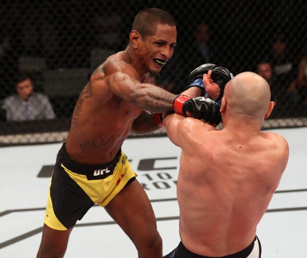 SAO PAULO, BRAZIL - NOVEMBER 19: Johnny Eduardo of Brazil punches Many Gamburyan of Armenia at the UFC Fight Night Bader v Minotouro at Ibirapuera Gymnasium on November 19, 2016 in Sao Paulo, Brazil. (Photo by Buda Mendes/Zuffa LLC/Zuffa LLC via Getty Ima