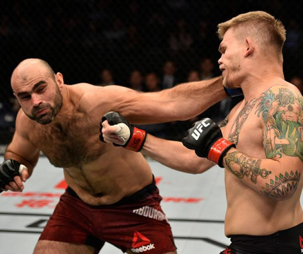 SHANGHAI, CHINA - NOVEMBER 25:  (L-R) Shamil Abdurakhimov of Russia punches Chase Sherman in their heavyweight bout during the UFC Fight Night event inside the Mercedes-Benz Arena on November 25, 2017 in Shanghai, China. (Photo by Brandon Magnus/Zuffa LLC