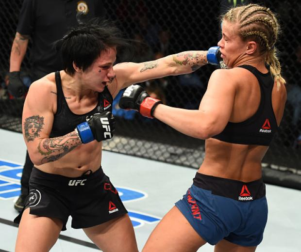 ST. LOUIS, MO - JANUARY 14:  (L-R) Jessica-Rose Clark of Australia punches Paige VanZant in their women's flyweight bout during the UFC Fight Night event inside the Scottrade Center on January 14, 2018 in St. Louis, Missouri. (Photo by Josh Hedges/Zuffa L