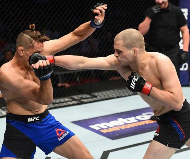 HOUSTON, TX - FEBRUARY 04:  (R-L) Alex Morono punches Niko Price in their welterweight bout during the UFC Fight Night event at the Toyota Center on February 4, 2017 in Houston, Texas. (Photo by Jeff Bottari/Zuffa LLC/Zuffa LLC via Getty Images)
