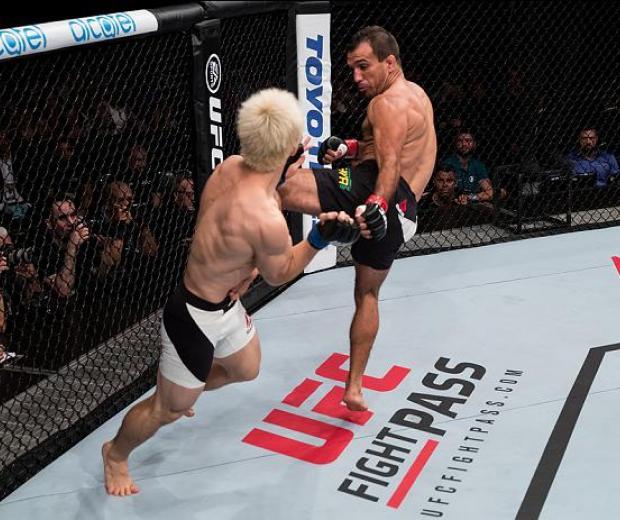 BRASILIA, BRAZIL - SEPTEMBER 24: Rani Yahya of Brazil kicks Michinori Tanaka of Japan in their bantamweight UFC bout during tthe UFC Fight Night event at Nilson Nelson gymnasium on September 24, 2016 in Brasilia, Brazil. (Photo by Buda Mendes/Zuffa LLC/Zu