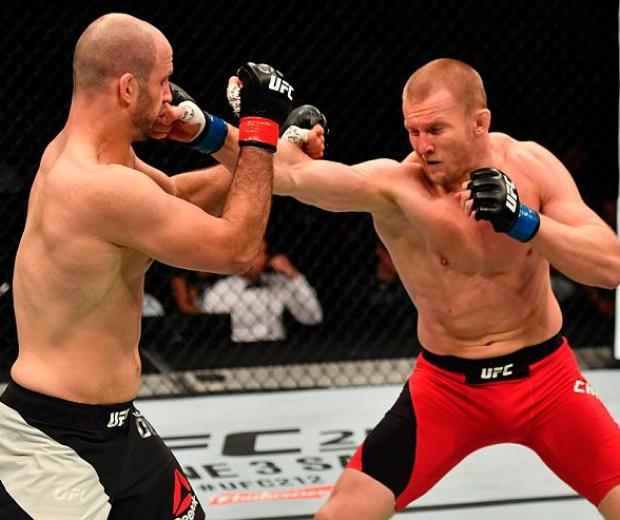 STOCKHOLM, SWEDEN - MAY 28:  (R-L) Misha Cirkunov punches Volkan Oezdemir in their light heavyweight fight during the UFC Fight Night event at the Ericsson Globe Arena on May 28, 2017 in Stockholm, Sweden. (Photo by Jeff Bottari/Zuffa LLC/Zuffa LLC via Ge