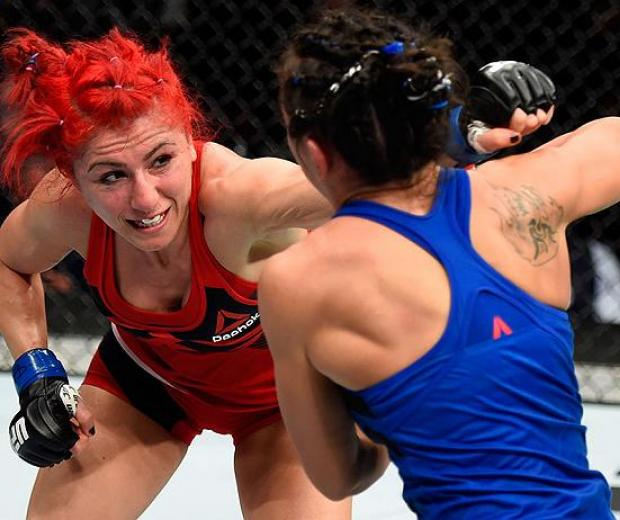 HALIFAX, NS - FEBRUARY 19:  (L-R) Randa Markos of Iraq punches Carla Esparza in their women's strawweight fight during the UFC Fight Night event inside the Scotiabank Centre on February 19, 2017 in Halifax, Nova Scotia, Canada. (Photo by Josh Hedges/Zuffa
