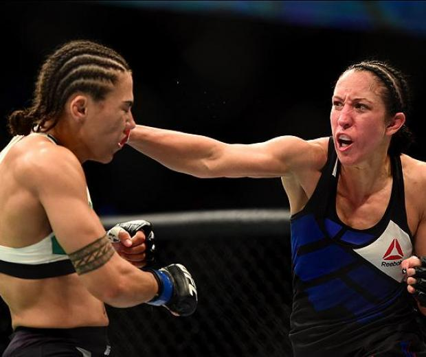 INGLEWOOD, CA - JUNE 04:  Jessica Penne lands a right on Jessica Andrade in their women's strawweight bout during the UFC 199 event at The Forum on June 4, 2016 in Inglewood, California.  (Photo by Harry How/Zuffa LLC/Zuffa LLC via Getty Images)