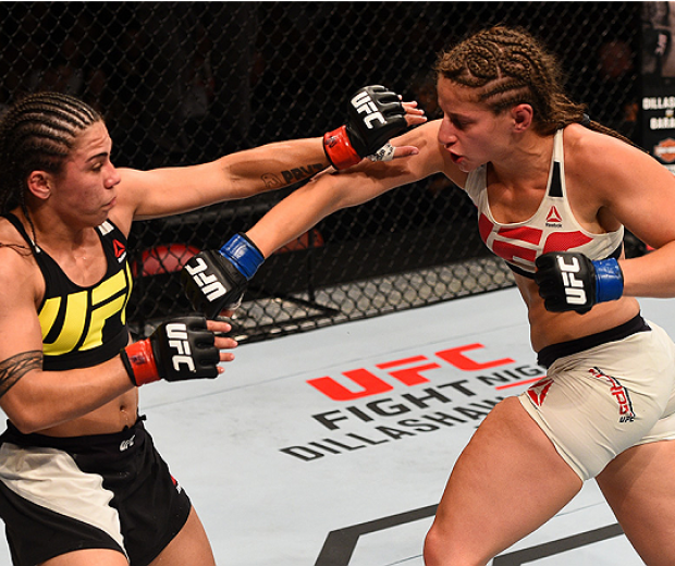 SAN DIEGO, CA - JULY 15:   (R-L) Sarah Moras of Canada punches Jessica Andrade of Brazil in their women's bantamweight bout during the UFC event at the Valley View Casino Center on July 15, 2015 in San Diego, California. (Photo by Jeff Bottari/Zuffa LLC/Z