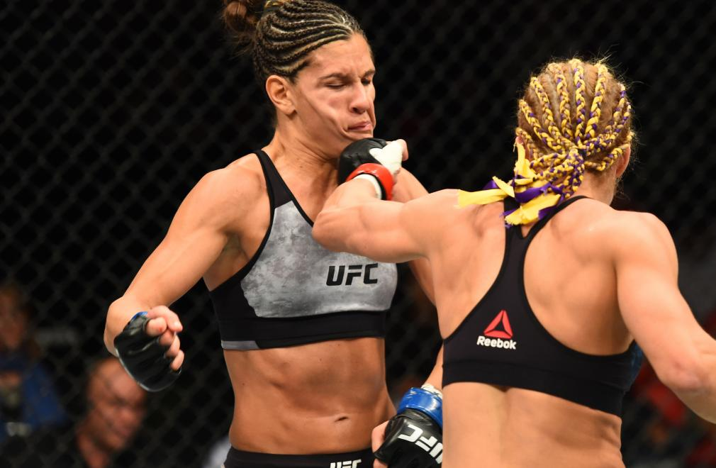 DETROIT, MI - DECEMBER 02: (R-L) Felice Herrig punches Cortney Casey in their women's strawweight bout during the UFC 218 event inside Little Caesars Arena on December 02, 2017 in Detroit, Michigan. (Photo by Josh Hedges/Zuffa LLC/Zuffa LLC via Getty Images)