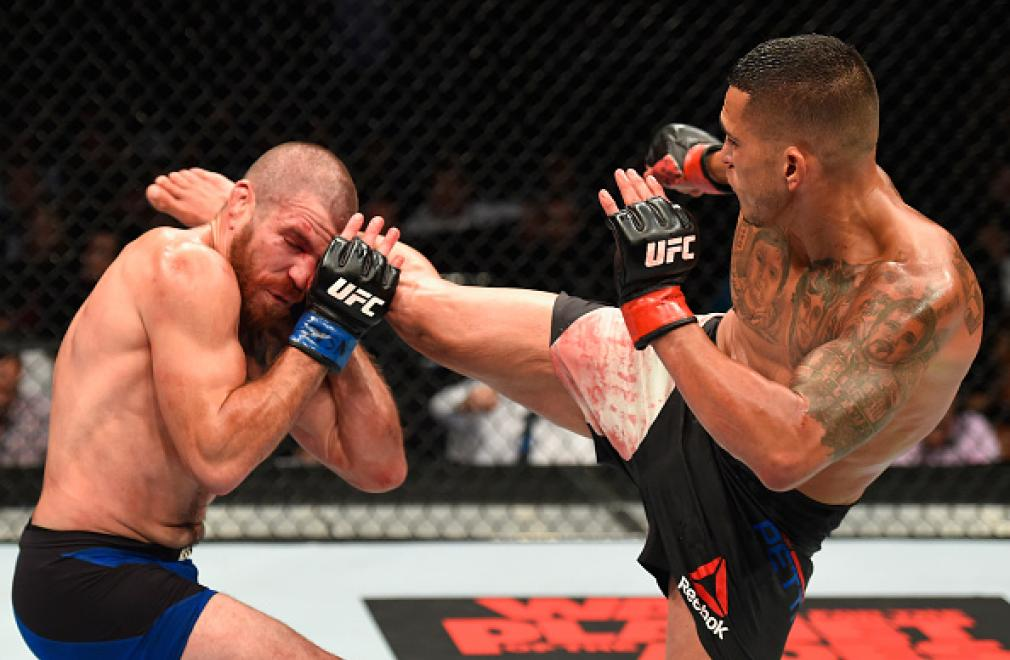 LAS VEGAS, NV - JULY 08:  (R-L) Anthony Pettis kicks Jim Miller in their lightweight bout during the UFC 213 event at T-Mobile Arena on July 8, 2017 in Las Vegas, Nevada.  (Photo by Josh Hedges/Zuffa LLC/Zuffa LLC via Getty Images)