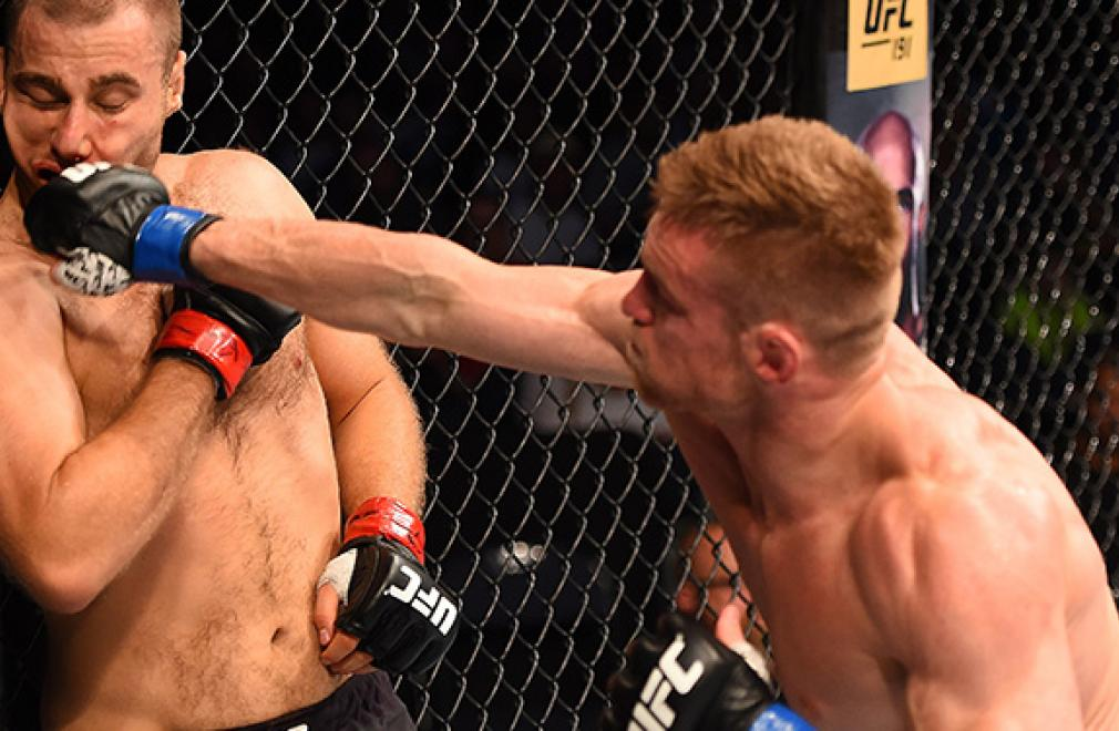 NASHVILLE, TN - AUGUST 08:  (R-L) Scott Holtzman punches Anthony Christodoulou of Greece in their lightweight bout during the UFC Fight Night event at Bridgestone Arena on August 8, 2015 in Nashville, Tennessee.  (Photo by Josh Hedges/Zuffa LLC/Zuffa LLC