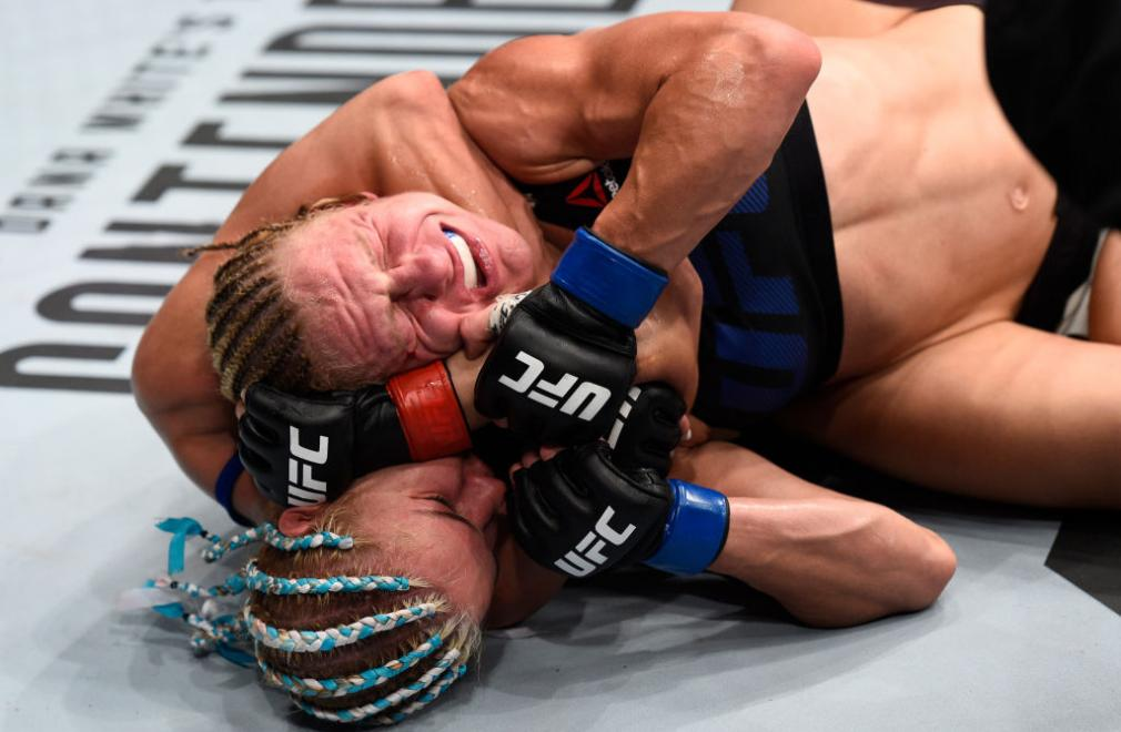 OKLAHOMA CITY, OK - JUNE 25:   (L-R) Felice Herrig attempts to secure a rear choke submission against Justine Kish in their women's strawweight bout during the UFC Fight Night event at the Chesapeake Energy Arena on June 25, 2017 in Oklahoma City, Oklahom