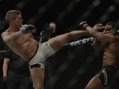 LAS VEGAS, NV - MARCH 04: (L-R) Stephen Thompson kicks Tyron Woodley in their UFC welterweight championship bout during the UFC 209 event at T-Mobile Arena on March 4, 2017 in Las Vegas, Nevada. (Photo by Jeff Bottari/Zuffa LLC/Zuffa LLC via Getty Images)