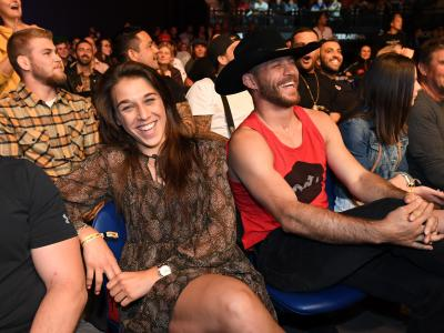 MELBOURNE, AUSTRALIA - FEBRUARY 10: (L-R) Joanna Jedrzejczyk and Donald Cerrone are seen in attendance during the UFC 234 at Rod Laver Arena on February 10, 2019 in the Melbourne, Australia. (Photo by Jeff Bottari/Zuffa LLC/Zuffa LLC via Getty Images)