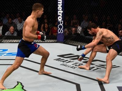 NASHVILLE, TN - APRIL 22: (L-R) Al Iaquinta knocks down Diego Sanchez with a right in their lightweight bout during the UFC Fight Night event at Bridgestone Arena on April 22, 2017 in Nashville, Tennessee. (Photo by Jeff Bottari/Zuffa LLC/Zuffa LLC via Getty Images)