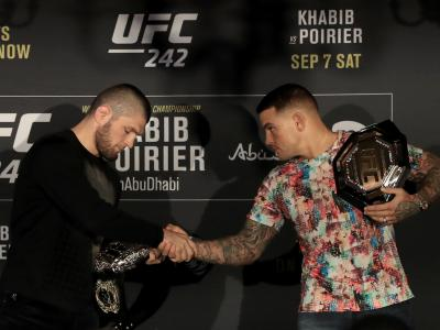 LONDON, ENGLAND - JUNE 12: Khabib Nurmagomedov and Dustin Poirier shake hands during a UFC 242 Press Conference at Hotel Cafe Royal on June 12, 2019 in London, England. (Photo by Marc Atkins/Zuffa LLC/Zuffa LLC)