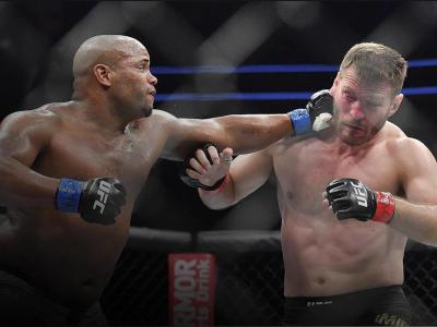 Daniel Cormier (L) lands a punch against Stipe Miocic during their heavyweight championship fight at T-Mobile Arena on July 7, 2018 in Las Vegas, Nevada. Cormier won by first round knockout. (Photo by Sam Wasson/Getty Images)