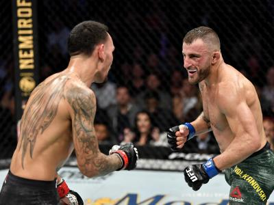 LAS VEGAS, NEVADA - DECEMBER 14: (L-R) Alexander Volkanovski of Australia eyes Max Holloway in their UFC featherweight championship bout during the UFC 245 event at T-Mobile Arena on December 14, 2019 in Las Vegas, Nevada. (Photo by Jeff Bottari/Zuffa LLC)