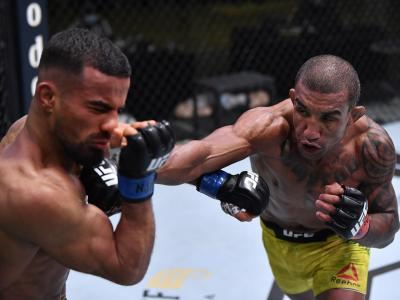 Raoni Barcelos of Brazil punches Khalid Taha of Germany in a bantamweight fight during the UFC Fight Night event at UFC APEX on November 07, 2020 in Las Vegas, Nevada. (Photo by Jeff Bottari/Zuffa LLC)