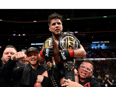 Henry Cejudo celebrates his TKO victory over Marlon Moraes of Brazil in their bantamweight championship bout during the UFC 238 event at the United Center on June 8, 2019 in Chicago, Illinois. (Photo by Jeff Bottari/Zuffa LLC)
