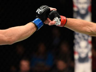Zak Ottow and Joshua Burkman touch gloves in their welterweight bout during the UFC Fight Night event at the Moda Center on October 1, 2016 in Portland, Oregon. (Photo by Josh Hedges/Zuffa LLC)