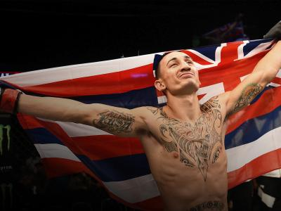 Max Holloway of the United States celebrates after his victory over Charles Oliveira in their featherweight bout during the UFC event at the SaskTel Centre on August 23, 2015 in Saskatoon, Saskatchewan, Canada. (Photo by Jeff Bottari/Zuffa LLC)