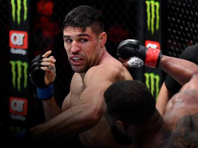 Vicente Luque punches Tyron Woodley in their welterweight fight during the UFC 260 event at UFC APEX on March 27, 2021 in Las Vegas, Nevada. (Photo by Jeff Bottari/Zuffa LLC)