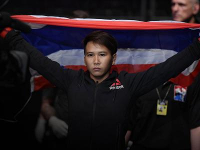 Loma Lookboonmee of Thailand prepares to enter the Octagon prior to her women's strawweight bout against Alexandra Albu of Moldova during the UFC Fight Night event at Singapore Indoor Stadium on October 26, 2019 in Singapore. (Photo by Jeff Bottari/Zuffa LLC via Getty Images)