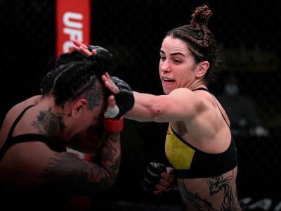 Norma Dumont of Brazil punches Ashlee Evans-Smith in their women's bantamweight bout during the UFC Fight Night at UFC APEX on November 28, 2020 in Las Vegas, Nevada. (Photo by Chris Unger/Zuffa LLC)