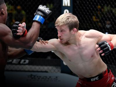 Arnold Allen of England punches Sodiq Yusuff of Nigeria in a featherweight fight during the UFC Fight Night event at UFC APEX on April 10, 2021 in Las Vegas, Nevada. (Photo by Chris Unger/Zuffa LLC)
