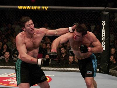 Forrest Griffin and Stephan Bonnar trade punches during the Light Heavyweight Final bout during the live Ultimate Fighter Season Finale at the Cox Pavilion on April 9, 2005 in Las Vegas, Nevada. (Photo by Josh Hedges/Zuffa LLC)