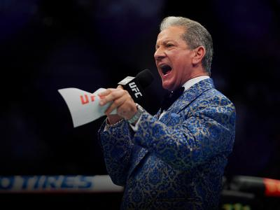 UFC Octagon Announcer Bruce Buffer signals the start of Shane Burgos and Edson Barboza of Brazil in their featherweight bout during the UFC 262 event at Toyota Center on May 15, 2021 in Houston, Texas. (Photo by Cooper Neill/Zuffa LLC)