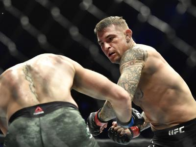Dustin Poirier punches Conor McGregor of Ireland in a lightweight fight during the UFC 257 event inside Etihad Arena on UFC Fight Island on January 23, 2021 in Abu Dhabi, United Arab Emirates. (Photo by Chris Unger/Zuffa LLC)