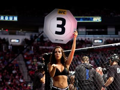 UFC Octagon Girl Luciana Andrade signals the start of round three between Derrick Lewis and Ciryl Gane of France in their interim heavyweight title bout during the UFC 265 event at Toyota Center on August 07, 2021 in Houston, Texas. (Photo by Cooper Neill/Zuffa LLC)